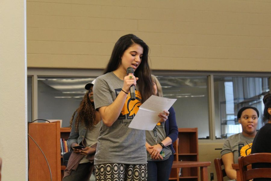 Aya Bellaoui leads Project LIT BHS in a trivia game about the novel, Dear Martin.