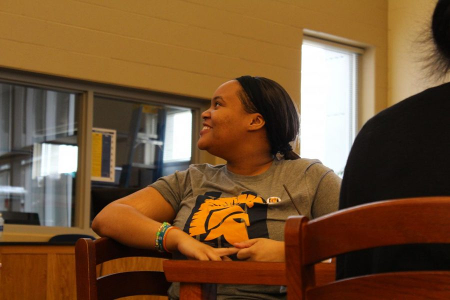 Imani Mitchell excitedly listens to Nic Stone talk about her book, Dear Martin.