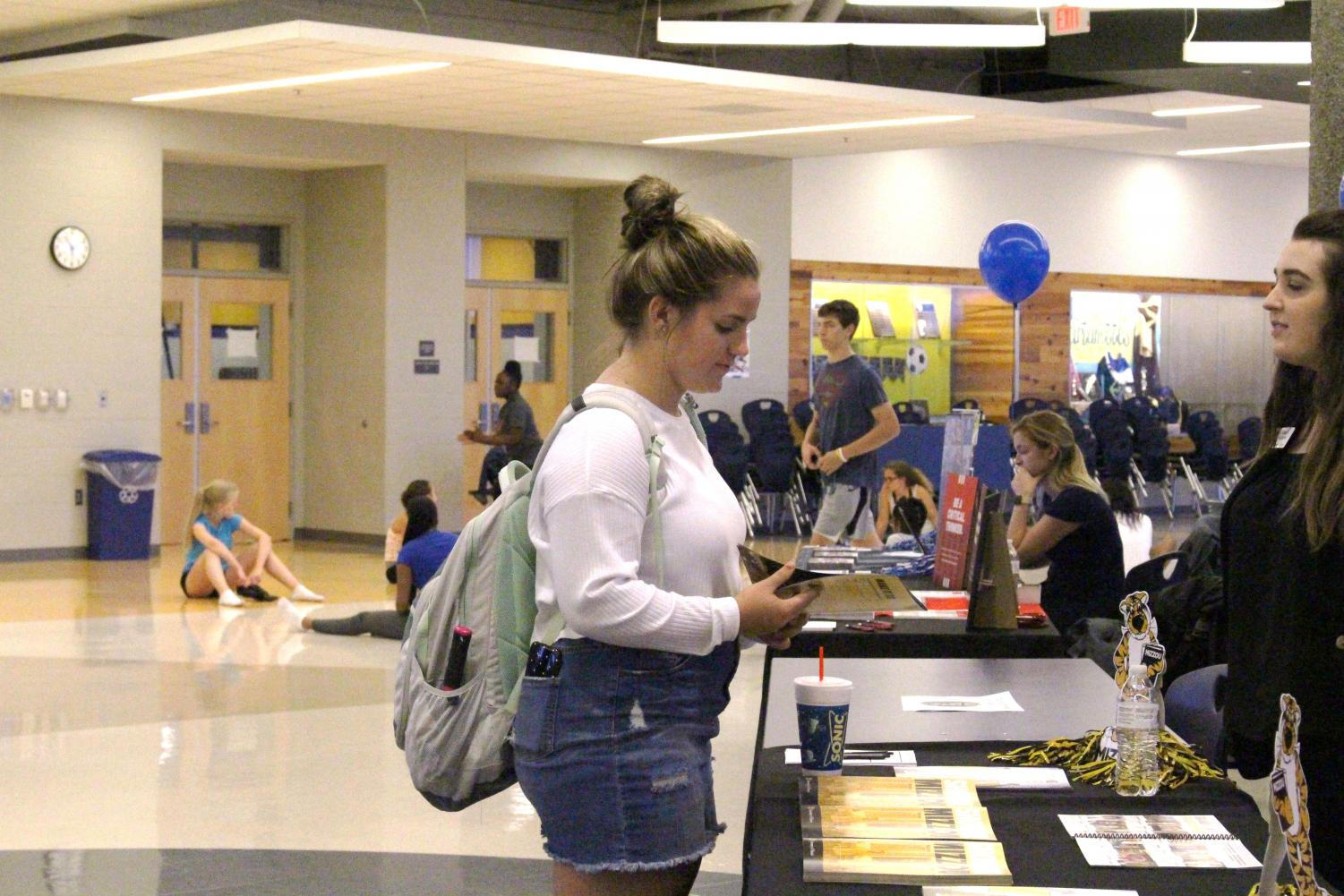 Emma McCormick speaks to the admissions rep from The University of Missouri.