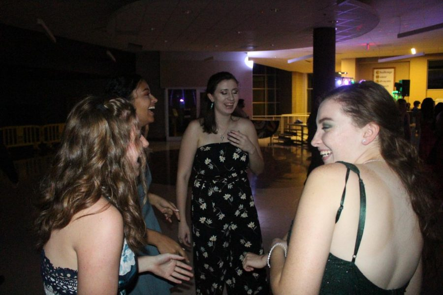 Taryn Criblez, Brihana Black, Kayli Lightner, and Emily Nowack laughing and enjoying the homecoming dance.