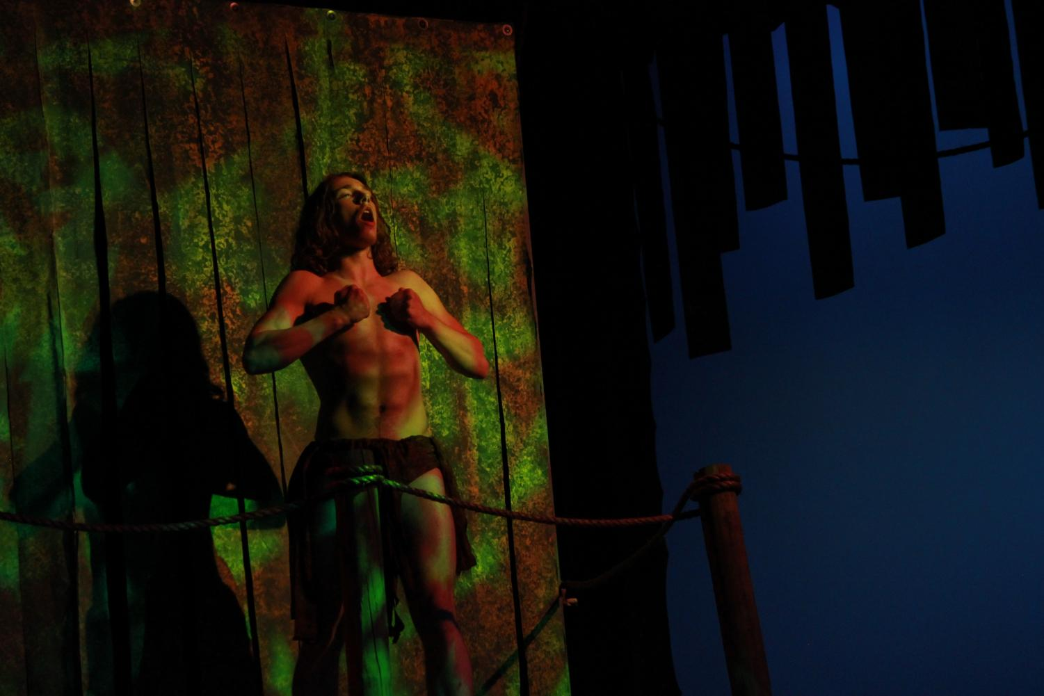 Jaydin Froeschner beats on his chest in this years Tarzan Musical.