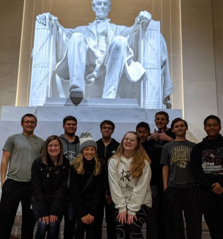 Battle journalism students pose for a picture in front of the Lincoln Monument.