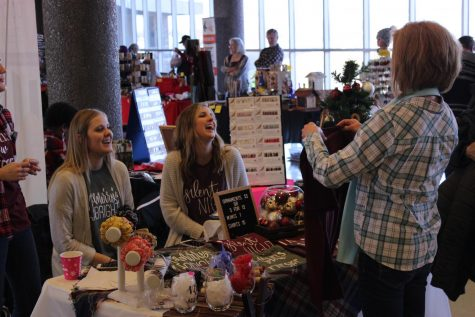 Venders chat with shoppers.  The vendors sold a wide variety of holiday items including t-shirts, ornaments, wine glasses, and more (Kenny Miller)