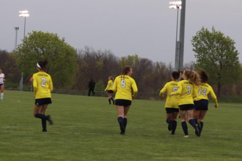 Natalie Giltrap, Bridget Anich, Krista Marks, Delaney Elleberacht, and Sarai Jones jog back to their side of the fidle for kick off after scoring a goal on Fatima in the Battle vs. Fatima game.