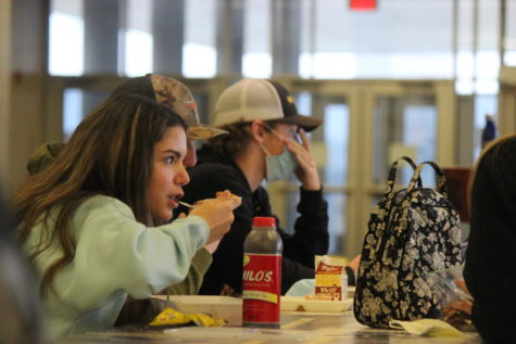 Students take advantage of their lunch hour chatting and filling up on food